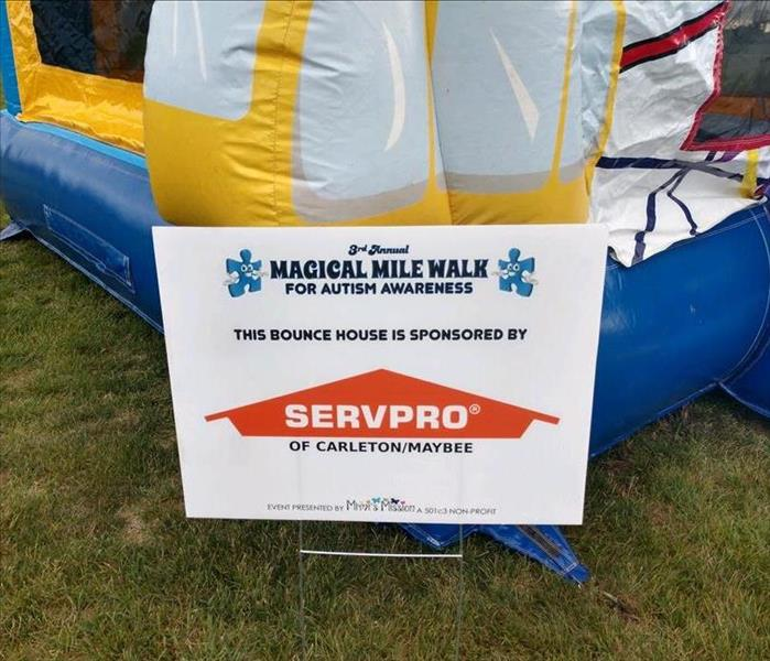 Sponsorship sign for Bounce House at Autism Awareness Walk