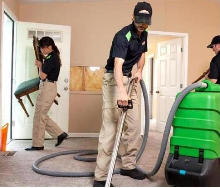 Vacuum cleaning dirty carpet